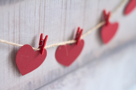 Red hearts on wooden background.Valentines day greeting card.