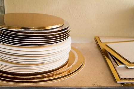 Gold and white coasters for cakes, rings for decorating cakes, baking tools, selektive focus
