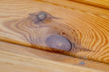 Background of natural wooden planks on the same surface with elements of knots. The theme of environmental friendliness. Standard-Bild