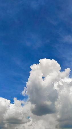 Beautiful blue sky and large white cumulus clouds, soft focus, background or concept. 스톡 콘텐츠