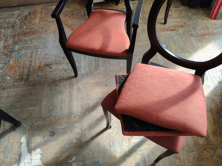Manufacturing and repair of furniture. Workers make wooden chairs with upholstered. Furniture production, handmade wooden furniture. Industrial plant.