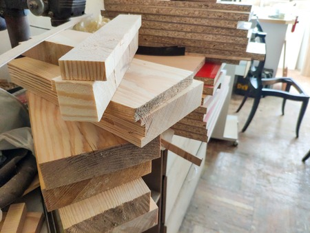 Cut wood pieces remaining from carpenter handcraft at furniture workshop, ready to recycle and reuse process