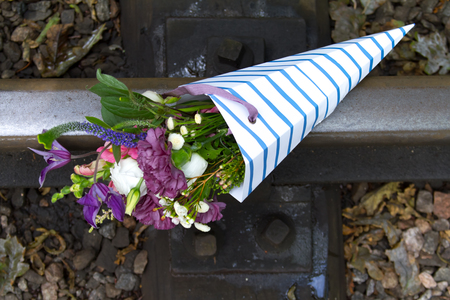 Close-up of bright wildflowers lying on rails, the concept of travel and vacation in summer. 版權商用圖片