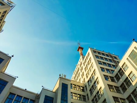 View up of State Industry Building or Gosprom built in Construction Art over blue sky, sun ray in the sky Archivio Fotografico - 127977050