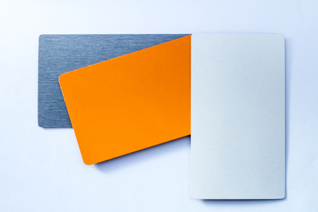 Concept of color cards on white background three colors grayscale and orange isolate on white background.