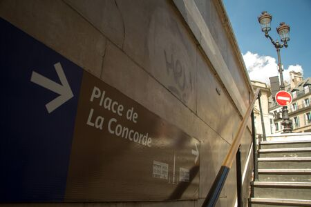 Paris, France - July 06, 2018: Bottom view of the exit sign from the metro station to Concord Square in Paris