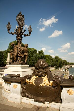 Paris, France - July 06, 2018: Closeup of architectural elements and statues on Alexander the Third Bridge in Paris