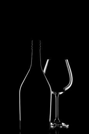A silhouette of a wine bottle and wine glass on black background