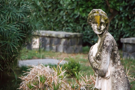 Marble statue of a bather in an abandoned park in Italy on the slope of Vesuvius, Naples Italy Editorial