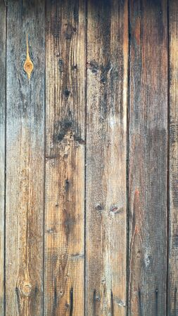Background or concept of old dark vintage boards fastened in a wooden shield, selective focus, copyspace Standard-Bild