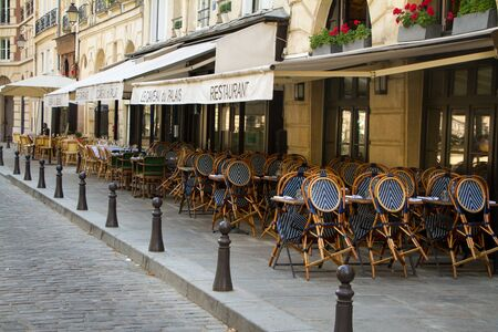 Paris, France - July 07, 2018: Summer area of several cafes, chairs set to tables awaiting opening