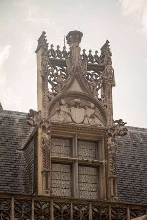 Paris, France - July 7, 2018: Architectural details and emblems of faculties on the roof of the Musee de Cluny a landmark national museum of medieval arts and Middle Ages