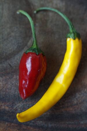 Close up top view of several red and yellow hot peppers on a wooden table, selective focus Stok Fotoğraf