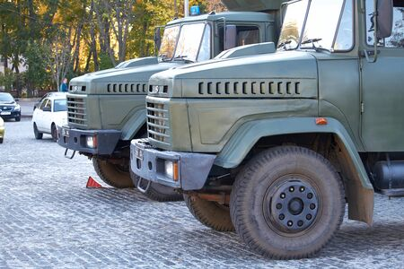 Kharkiv, Ukraine - October 14, 2019: Two military trucks keep order during events in a city park