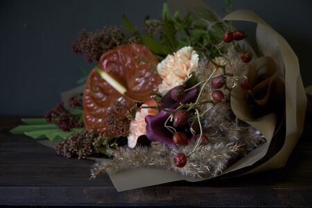 Close-up bouquet decorated in vintage style on a dark background, selective focus Reklamní fotografie