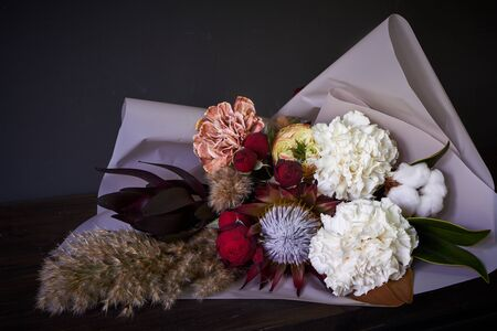 Close up bouquet decorated in vintage style on a dark background, selective focus