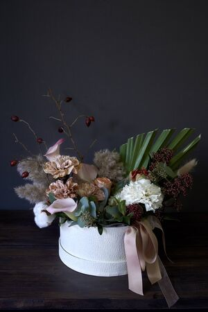 Box with a vintage bouquet on a dark background, selective focus Reklamní fotografie