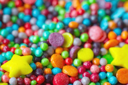 Extremely close up colorful heart-shaped confectionery powder, selective focus
