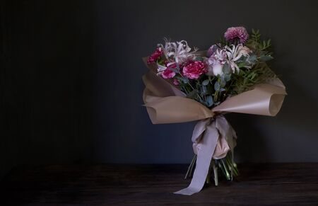 Close up of bouquet decorated in vintage style on a dark background, selective focus Reklamní fotografie