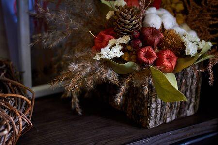Close up decorative autumn composition in a basket, selective focus