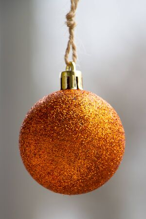 New Year or Christmas background, close-up golden Christmas ball on blurred background, selective focus