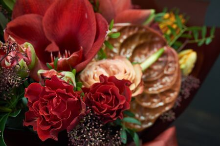 Detail close up chic autumn bouquet in red colors in vintage style on a dark background, selective focus