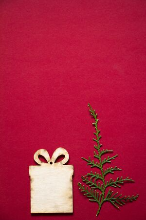 Christmas backgrounds, various wooden decor on red background, selective focus