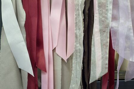 Close up of a lot of ribbons hanging on a hanger, selective focus Imagens