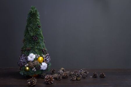 Christmas tree made of fir branches and decorated by natural materials and many cones, selective focus Imagens