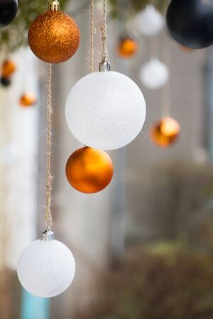 New Year or Christmas background, close-up of white and gold Christmas balls on blurred background, selective focus