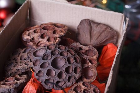 Close up of homemade box with decorative details for decorating bouquets and wreaths, selective focus