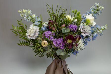 An original Provence style open bouquet, gray backdrop, selective focus Stock Photo