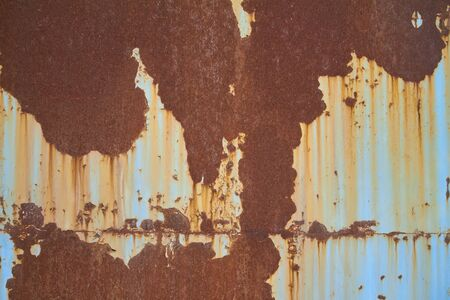 Multicolored background, rusty metal surface with blue paint flaking, cracking texture Stock Photo