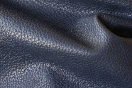 Closeup natural qualitative blue leather texture, selective focus