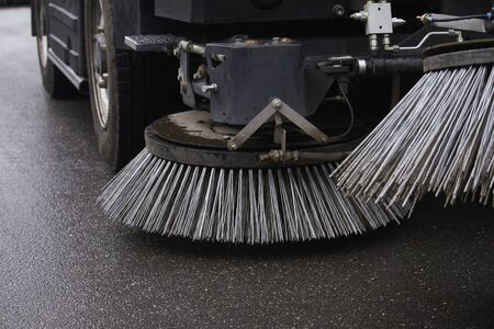 Closeup sweeper machine cleaning. Concept clean streets from debris. Selective focus.