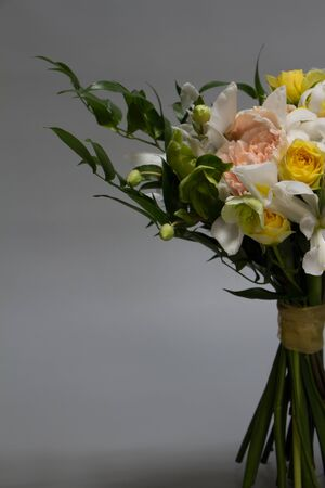 Wedding or greeting bouquet in vintage style, light grey background, selective focus