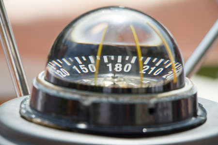 Gyro compass on an expensive yacht close up. Yacht navigation equipment. Selective focus.