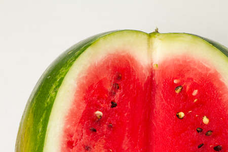 Close-up sliced ripe red watermelon on white background, top view
