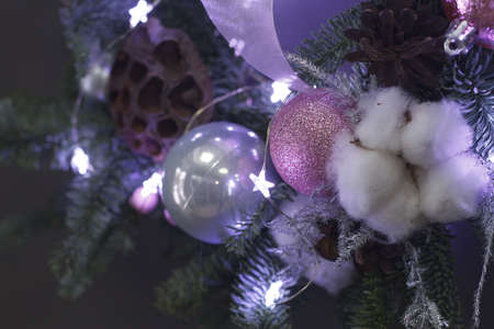 Extreme close-up detail of Christmas wreath of vines decorated with fir branches, Christmas balls and natural materials, New Year concept