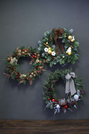 Christmas wreaths of vines decorated with fir branches, Christmas balls and natural materials, New Year concept