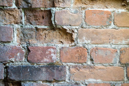 Close up red damaged brick wall, selective background, copy space Archivio Fotografico