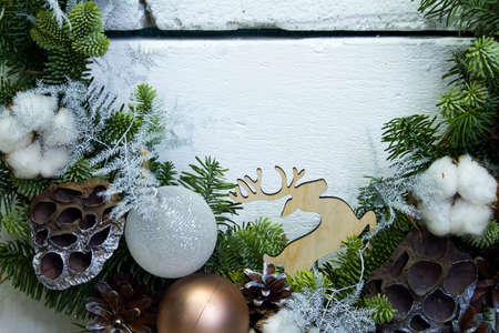 Close-up Christmas horseshoe wreath of vines decorated with fir branches, Christmas balls and natural materials, New Year concept