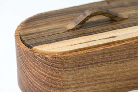 Natural wood round handmade box, olive tree box isolated on white backdrop