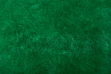Green faux fur background, new year or Christmas background concept