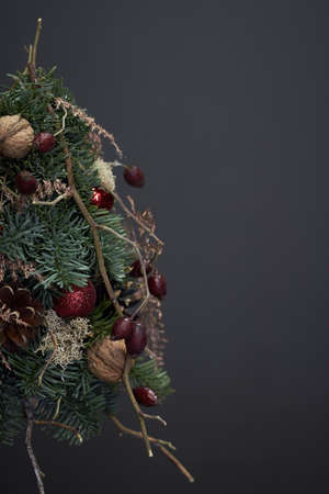 Beautiful winter Christmas tree made of fresh Nobilis spruce, decorated with festive ornaments and pine cones Archivio Fotografico