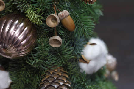 Beautiful winter Christmas tree made of fresh Nobilis spruce, decorated with festive ornaments and pine cones Reklamní fotografie