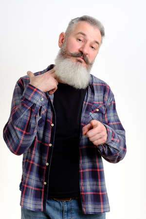 Studio portrait of mature bearded man in casual clothes gestures it is time to drink alcohol, bad habit concept, white backdrop