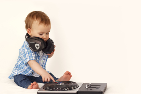 little boy in headphones with remote control Stock Photo