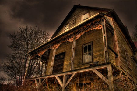An old abandoned wooden house in fall setting