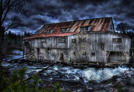 Old wooden mill by the riverside